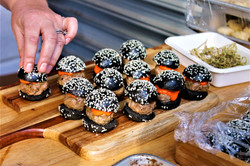 One-bite sliders in charcoal brioche buns.  Canape cuisine from A Moveable Feast Catering