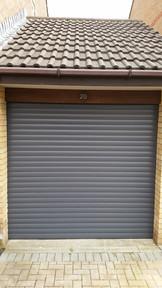 Electric-roller-door-in-dark-gray.jpg
