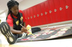 Freshman Nicole Bolton paints sign