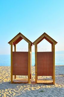 two-wooden-beach-changing-rooms-58646804
