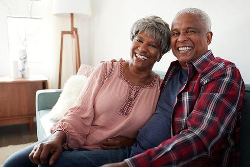 Portrait Of Loving Senior Couple Relaxing On Sofa At Home_edited.jpg