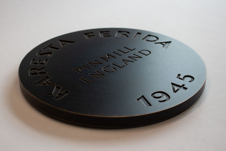 Machined and patinaed bronze plaque