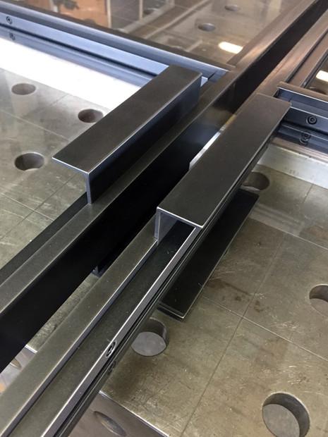 detail of blackened steel doors