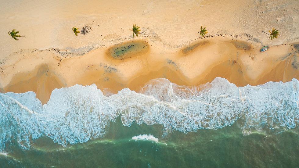 high-angle-shot-of-the-beautiful-foamy-waves-in-northern-brazil-ceara-fortaleza-cumbuco-parnaiba.jpg