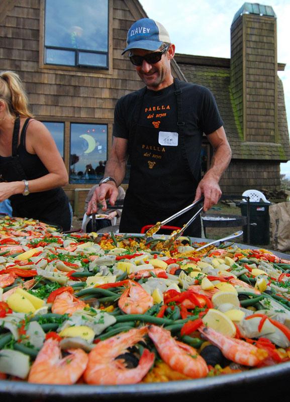Serving paella in Dillon Beach