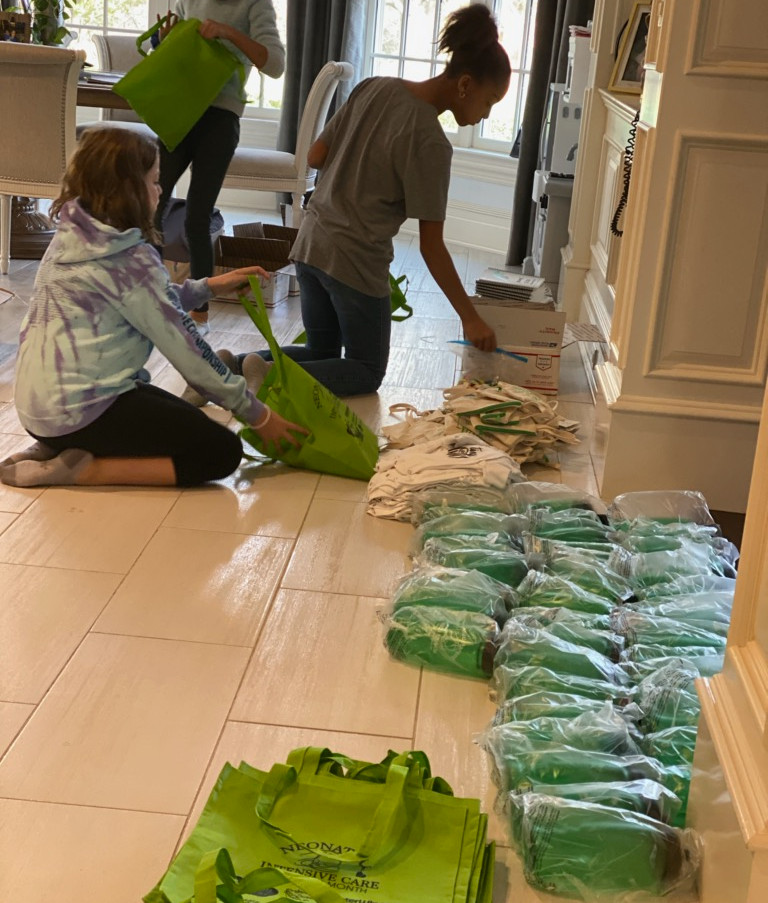 girl scouts putting bags together.jpg