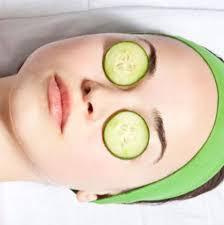 cucumber slices on eyes
