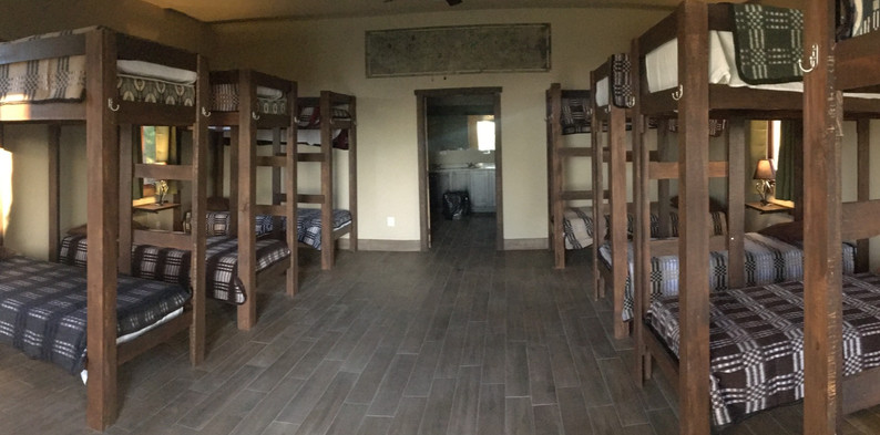 Ignite has two gender dorms that each sleep 20 with bunk style bedding. The bathroom is equipped with 3 shower stalls, 3 sinks, and 3 toilet stalls with flushing toilet paper and clean water