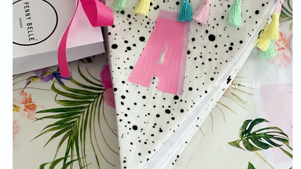 Splash print bunting with pastel tassels