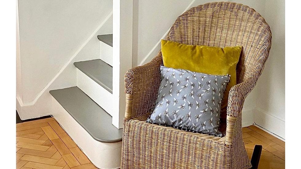 Bee print cushion with Pom-Pom edge