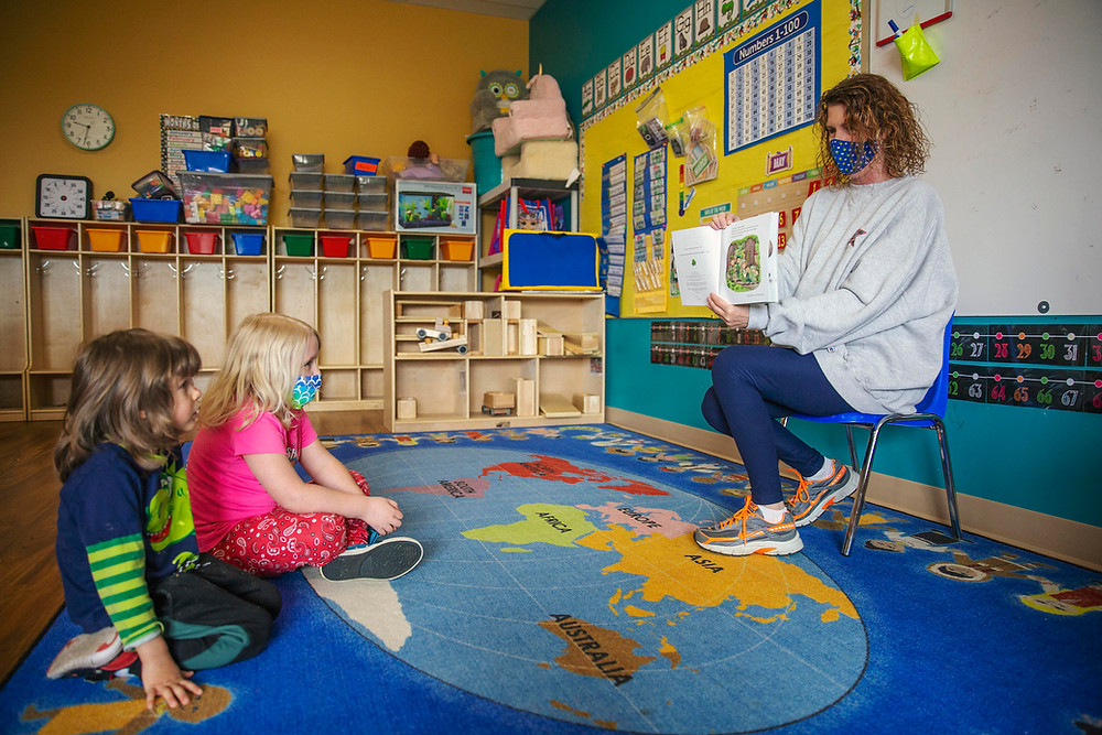 A teacher reads to kids at Step by Step School for Early Learning in State College, Pa.
