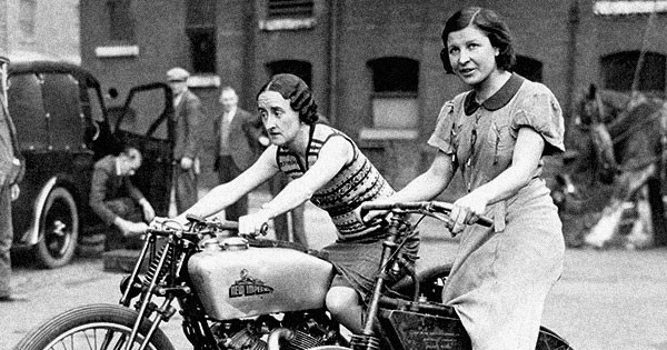 Two ladies astride an 1895 Crank Drive Motorcycle and a 500 New Imperial Twin photo found on Flashbak.com