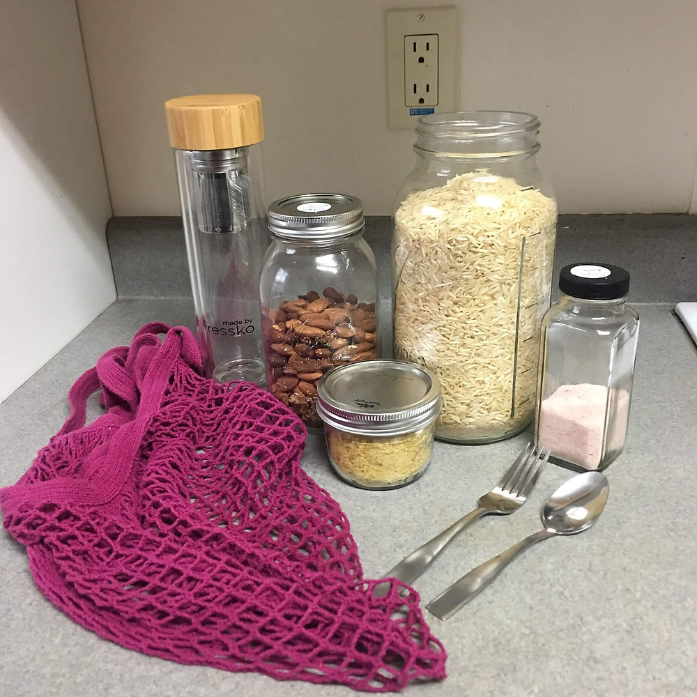 Zero Waste starter kit includes a mesh bag, water bottle. food containers, and metal/wooden cutlery. Image source : Wikipedia