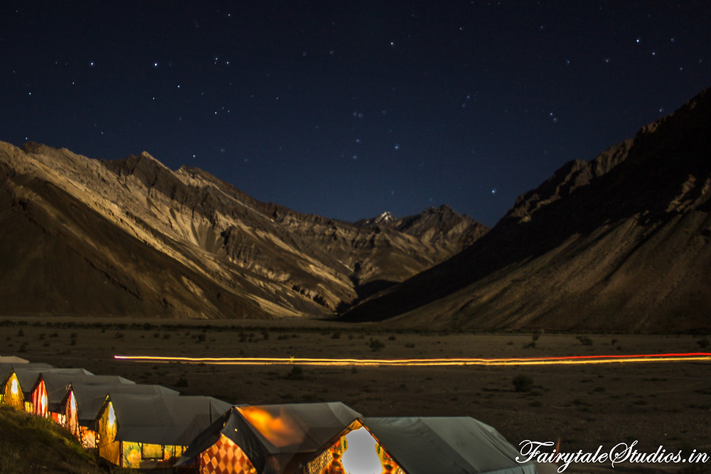 Stars shining as a vehicles zooms past our camps in Rangdum (The Zanskar Odyssey Travelogue)
