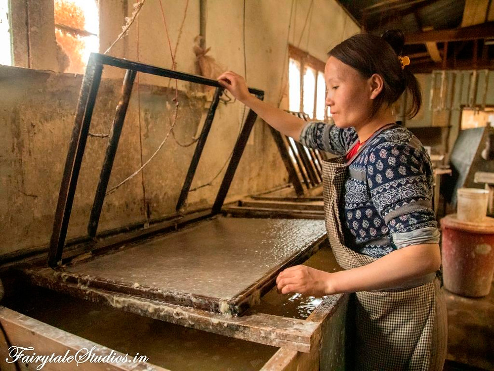 A lady working at a paper factory, Thimphu, Bhutan
