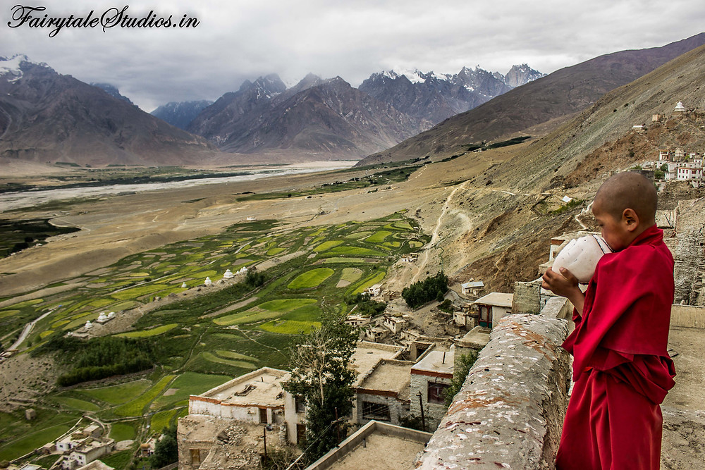 A child monk blowing conch to the village signalling lunch time (The Zanskar Odyssey Travelogue)