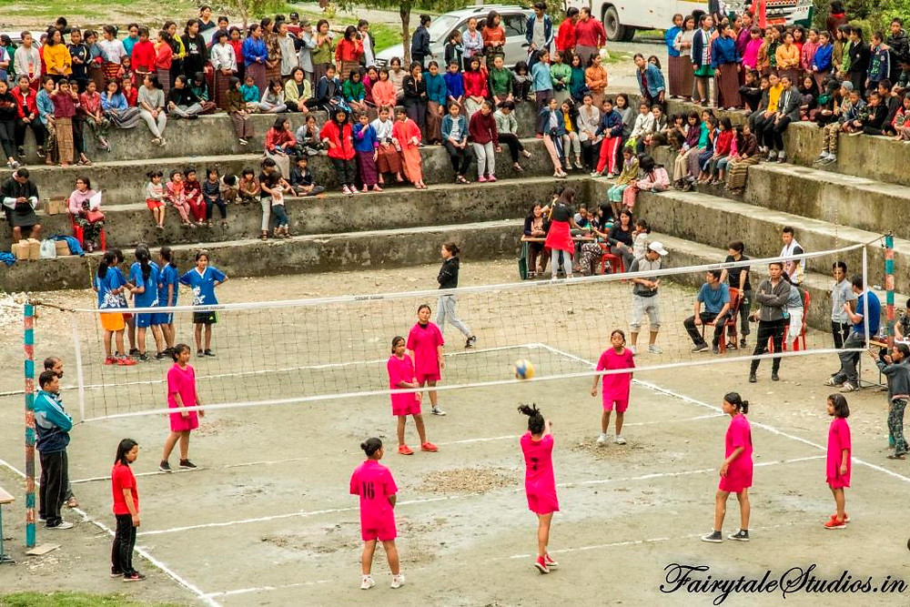 Girls playing a volleyball match with audience cheering for them in a school in Phuentsholing, Bhutan_Bhutan photoblog