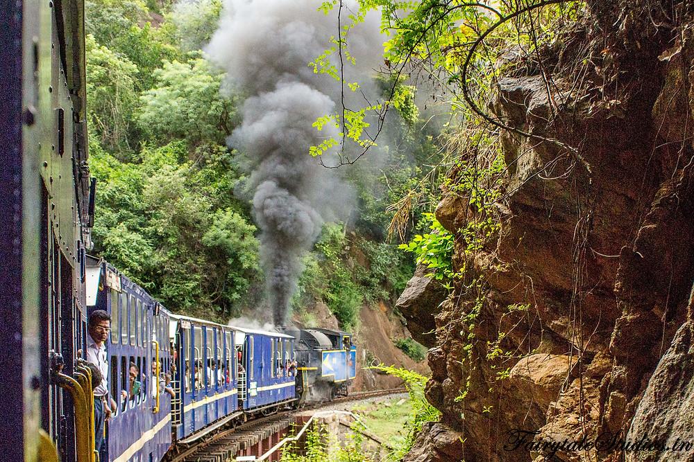 The Nilgiri mountain rail cutting through Nigiri hills