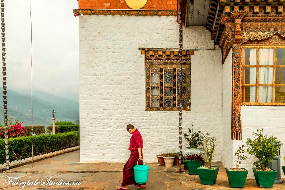 A nun working at a nunnery in Punakha, Bhutan