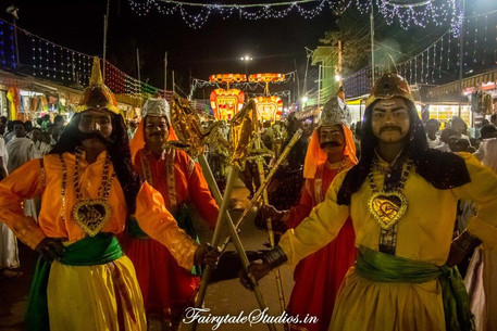 People dressed in mythological costumes playing guards in the Dussehra carnival of Srisailam