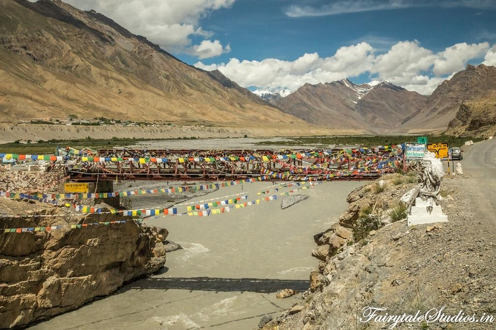 A flag laden bridge over Spiti River in Kaza, Spiti Valley_Plan your trip to Spiti Valley