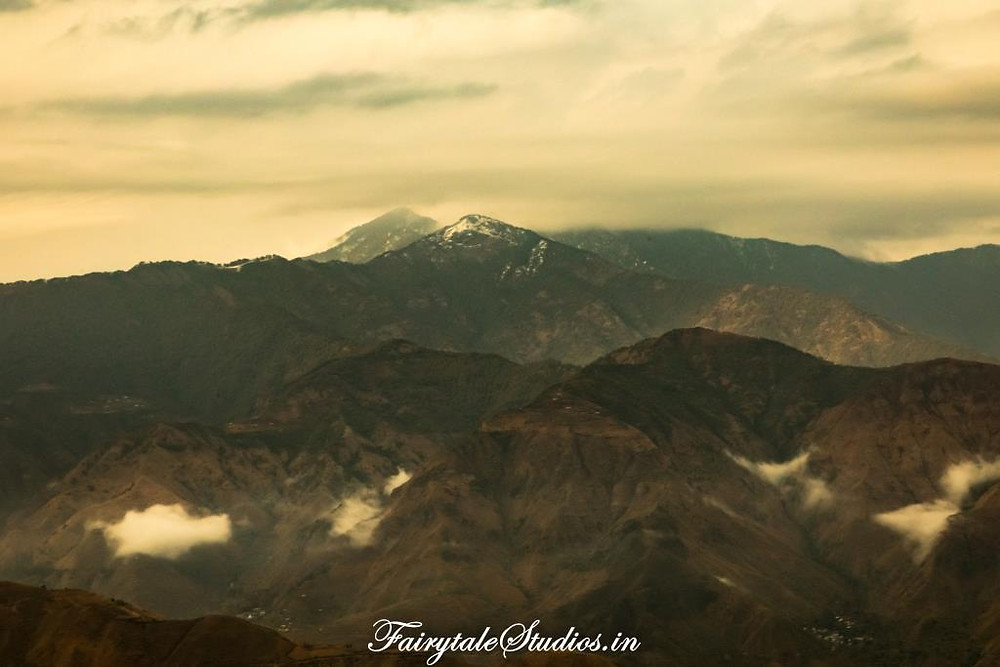 Snow-covered Himalayan peaks as seen from Lal Tibba view point, Landour, Uttarakhand - India