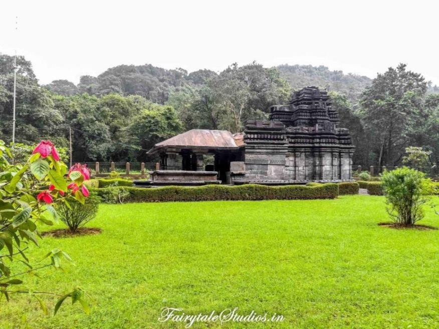 Tambdi Surla Temple made of black besalt and surrounded by lush green gardens