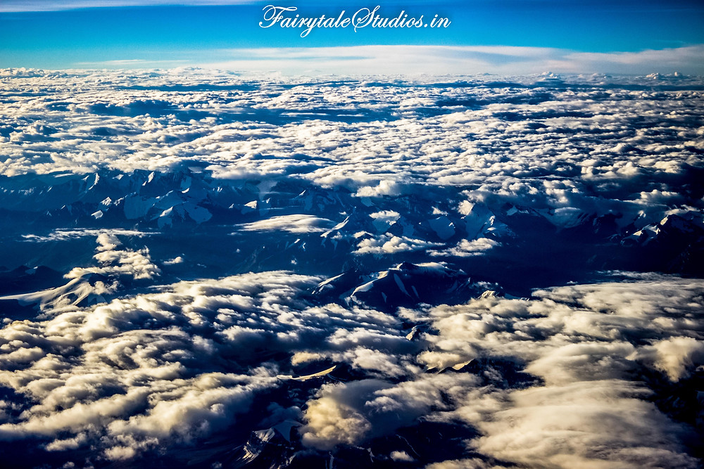 Snow clad grand Himalayas masked by scattered clouds (The Zanskar Odyssey)