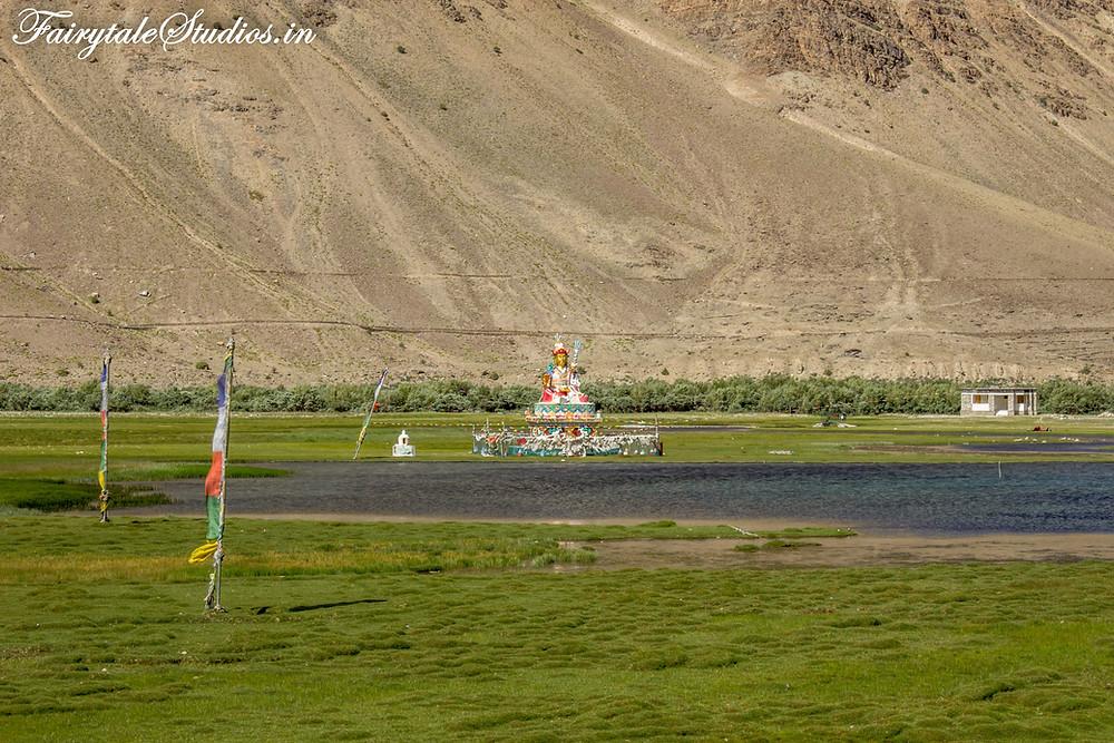A statue of Maitreya Buddha besides a lake just before Padum, Zanskar (The Zanskar Odyssey Travelogue)