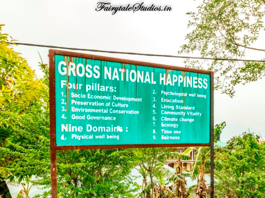 A board explaining the nine domains and four pillars on which Gross National Happiness is measured in Bhutan - The Bhutan Odyssey