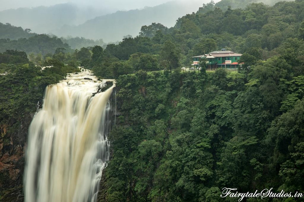Prakruthi Yatri Niwas seen in the background of Jog Falls, Karnataka - India