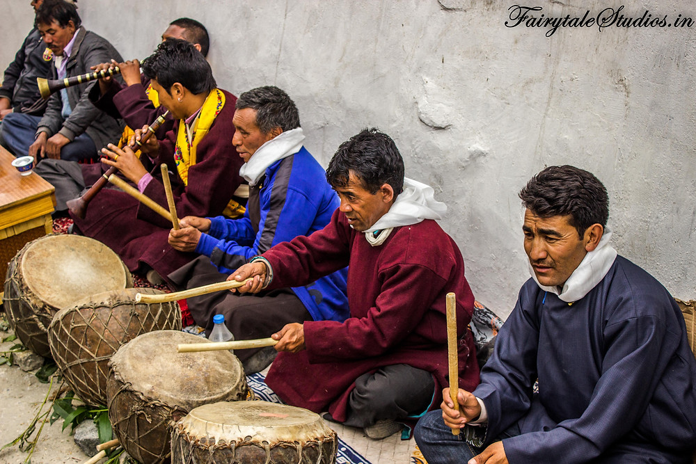 Men playing musical instruments celebrate Mentok Stano in Mulbekh monastery (The Zanskar Odyssey travelogue)