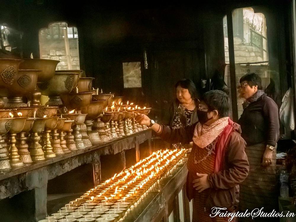 Lighting lamp at Memorial Chorten in Bhutan