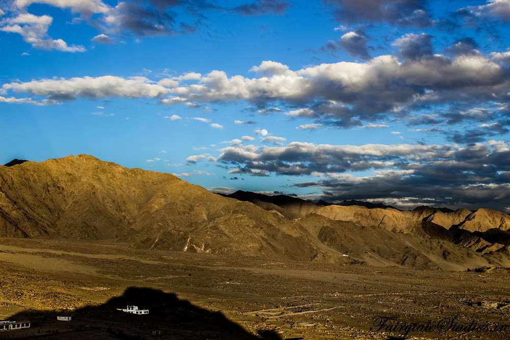 View from Thiksey monastery with moon rising in the background (The Zanskar Odyssey)