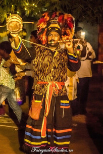 Tribal people probably from nearby villages playing musical instruments in Dussehra carnival of Srisailam