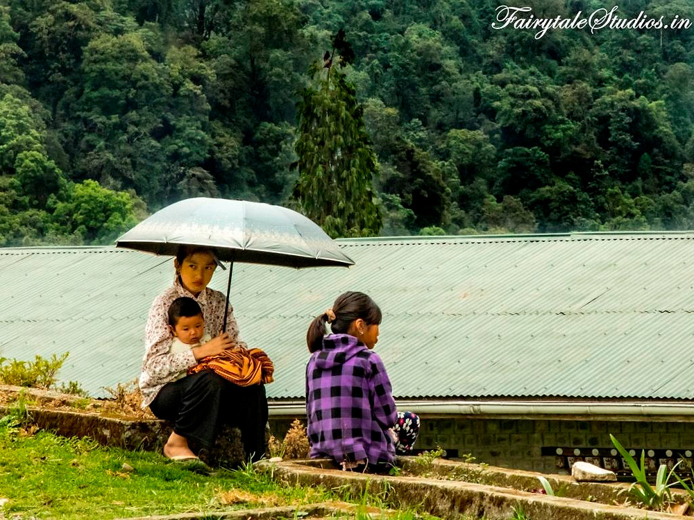 A lady with a child watching sports in a Bhutanese school_Bhutan photoblog