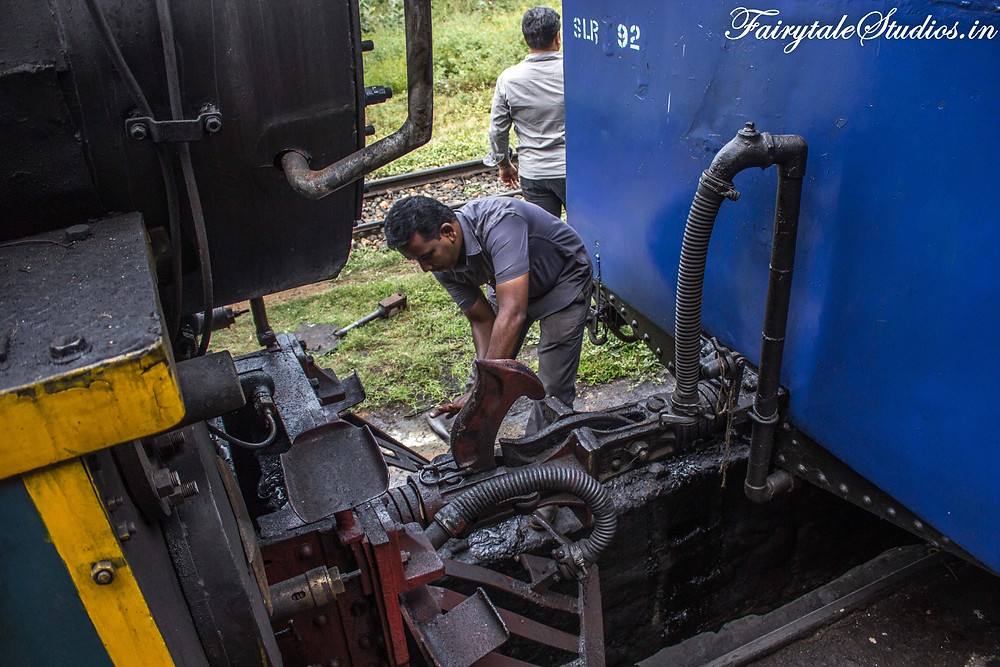 A mechanic shunting the engine with rest of the coaches