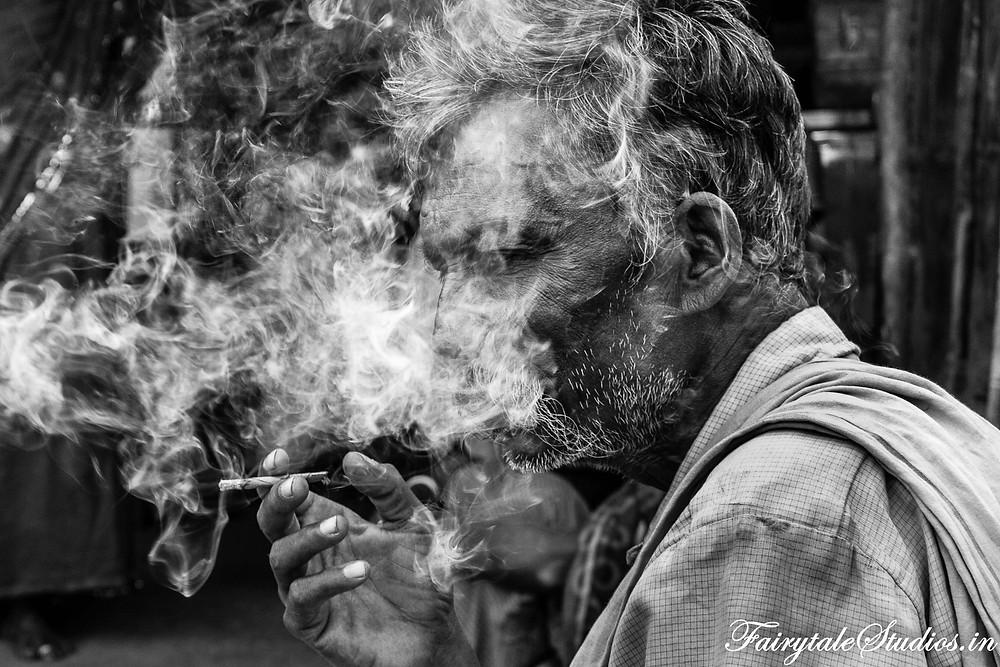 An old man smoking a beedi. Met him in a village before Mallela Theertham waterfalls