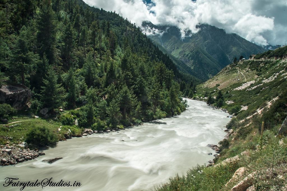 Ferociously flowing Baspa River surrounded by high mountains in Chitkul village_Kinnaur valley, Himachal Pradesh - India