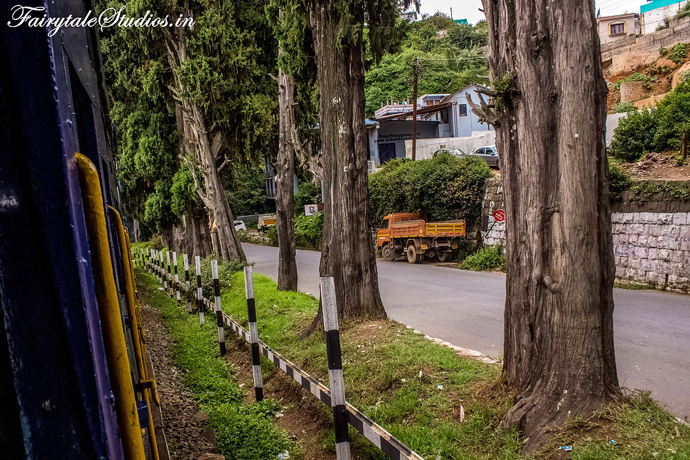 Road runs parallel to the track in coonoor
