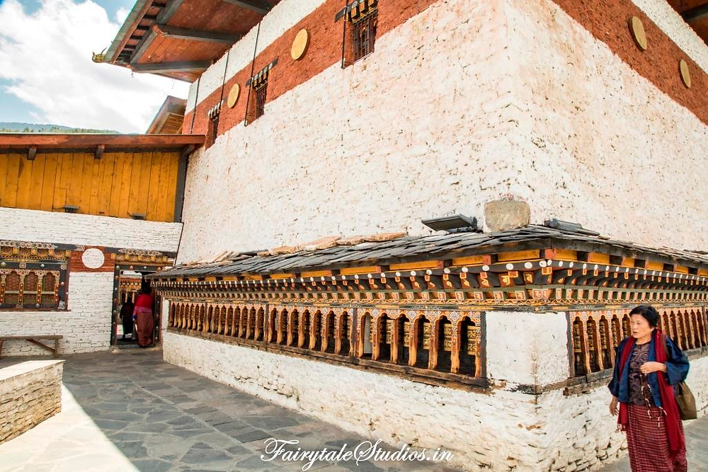 A line of prayer wheels outside the Chnagangkha Lhakhang, Thimphu_The Bhutan Odyssey_Places to visit in Bhutan