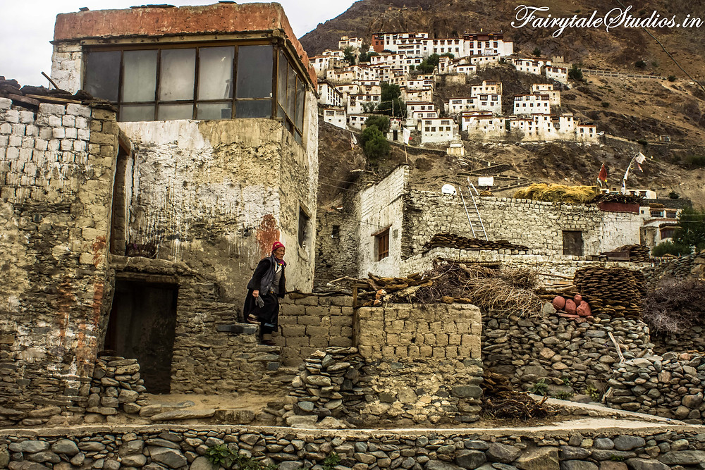 An old woman climbing down the stairs from her home in Karsha Village near Padum  (The Zanskar Odyssey travelogue)