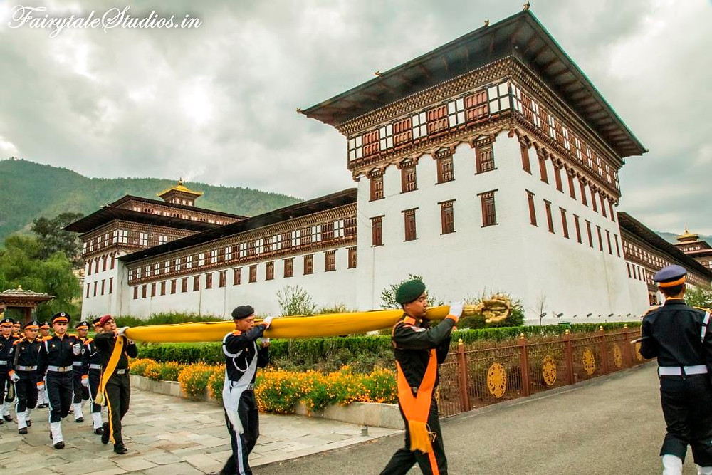 The national flag of Bhutan being unfurled at the Tashichho Dzong, Thimphu in the evening_The Bhutan Odyssey_Places to visit in Thimphu