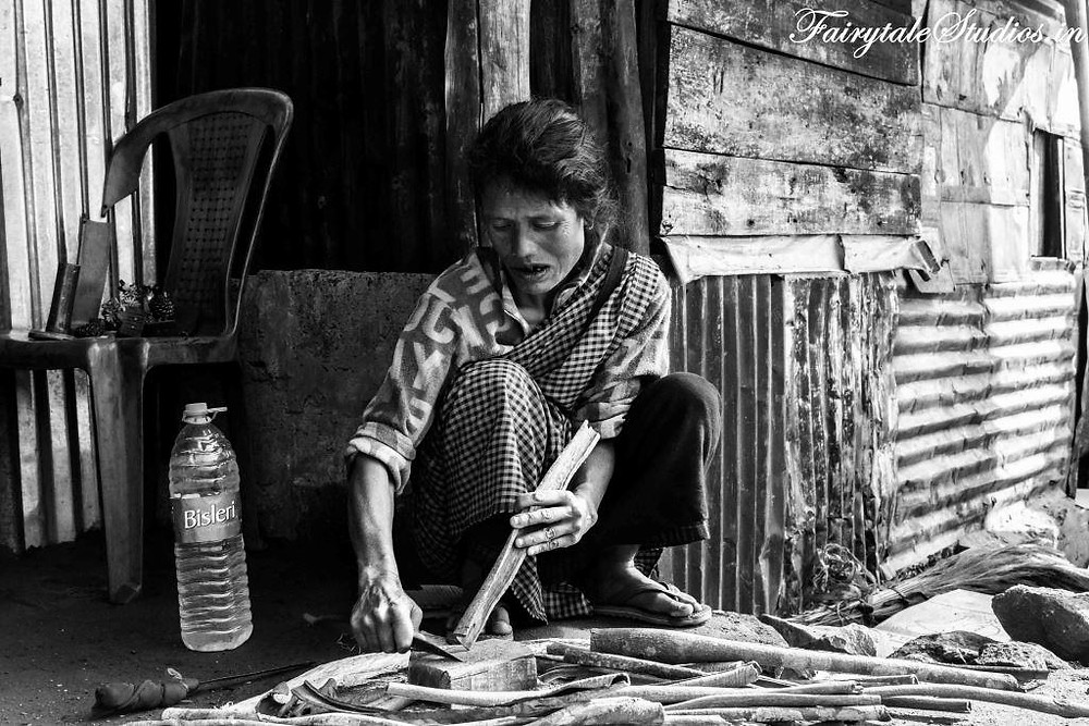 Women chewing Kwai while cutting wood