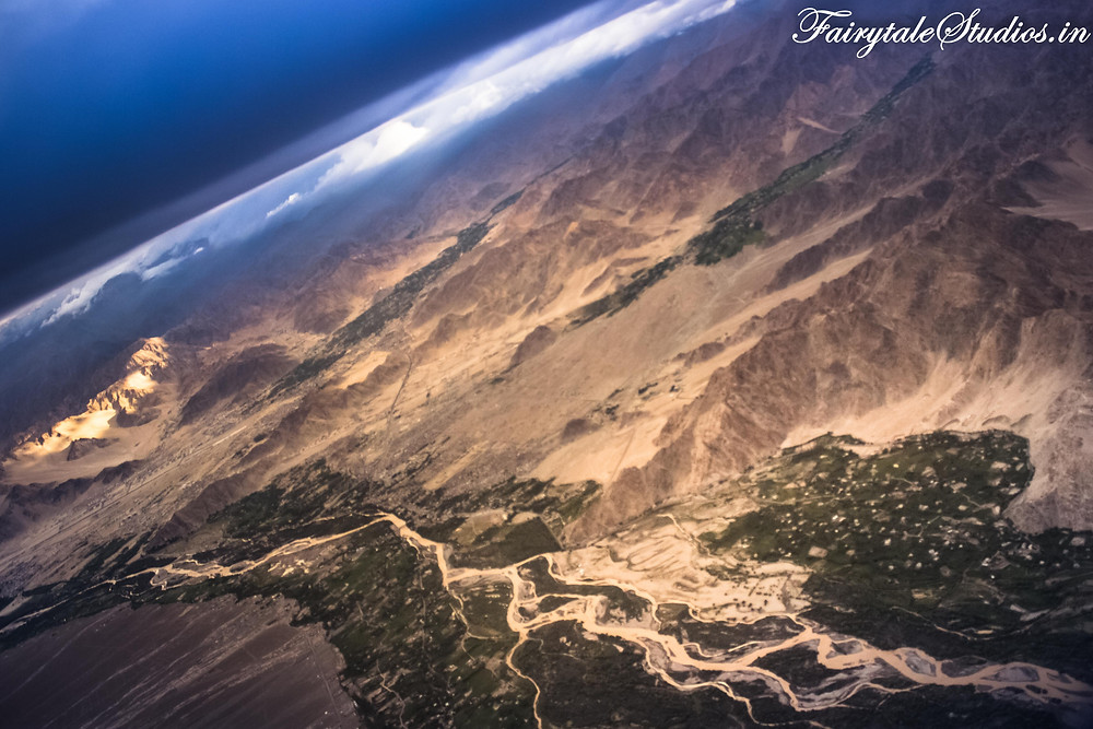 River flowing through a city in Ladakh surrounded by barren desert & Himalayas (The Zanskar Odyssey)