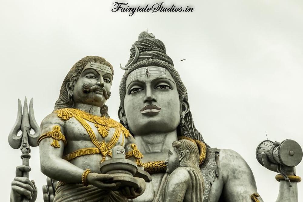 Ravana and disguised Ganesha with Lord Shiva in backdrop at Murudeshwar