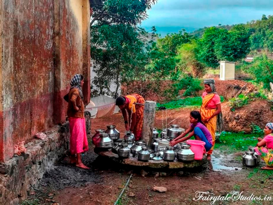 Women fetching water from the common village tap in Purushwadi village, Maharashtra, India