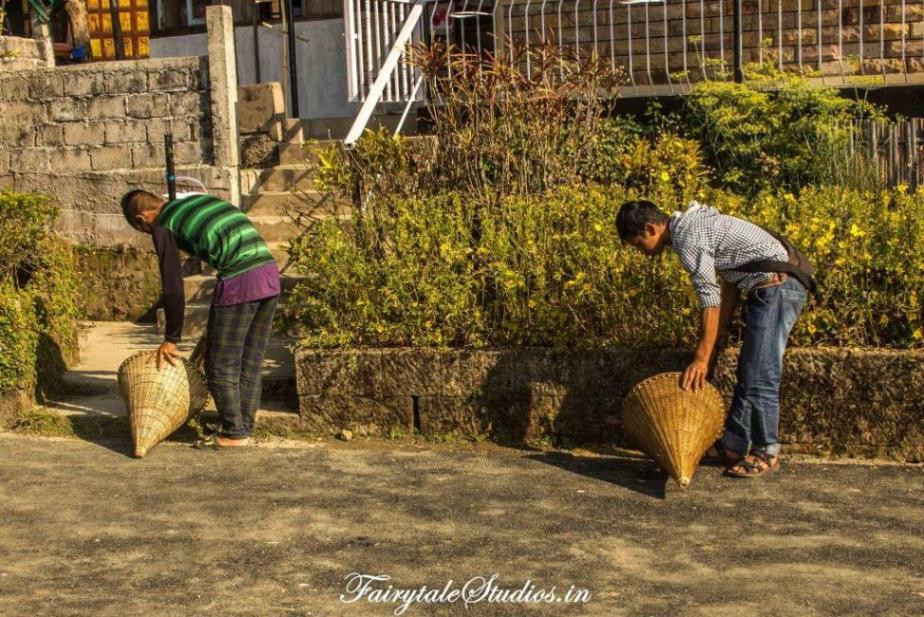 Villagers cleaning streets of Mawlynnong, India - the cleanest village of Asia