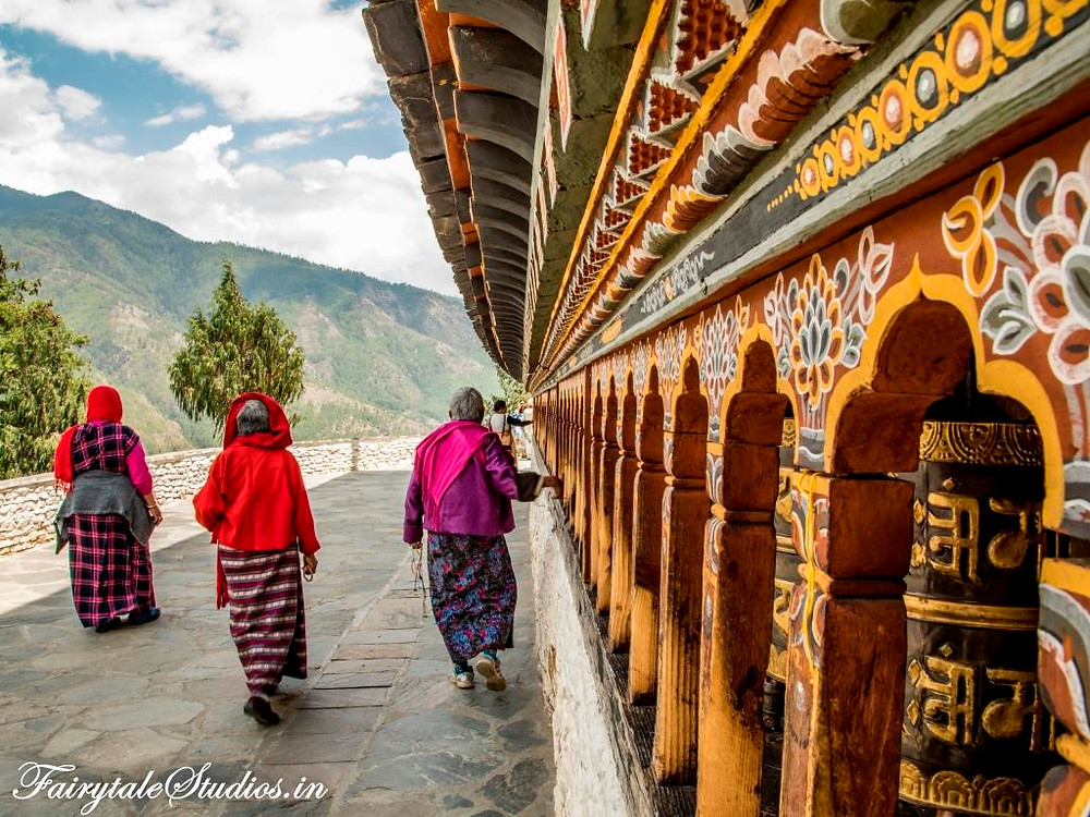 The red robed monks whirling the prayer wheels at Changangkha Lhakhang, Thimphu_The Bhutan Odyssey_Places to visit in Bhutan