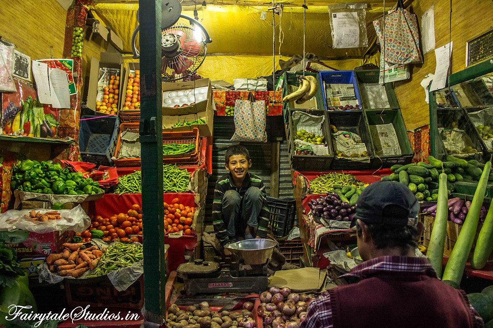 A kid selling fruits and vegetables in Kargil (The Zanskar Odyssey travelogue)